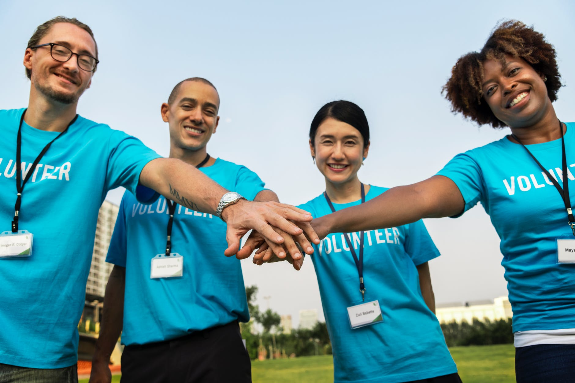 group of volunteer doing a teamwork gesture